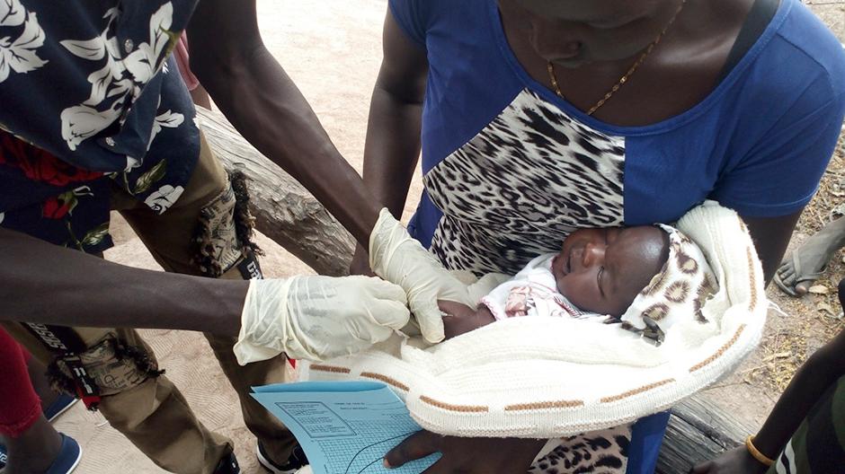 child receiving immunization
